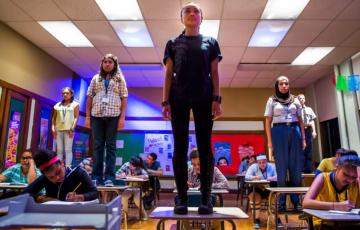Students standing on desks